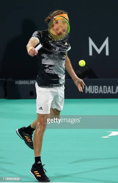 Stefanos Tsitsipas of Greece returns the ball to Serbia's Novak Djokovic in their semi-final match of the Mubadala World Tennis Championship at Zayed...