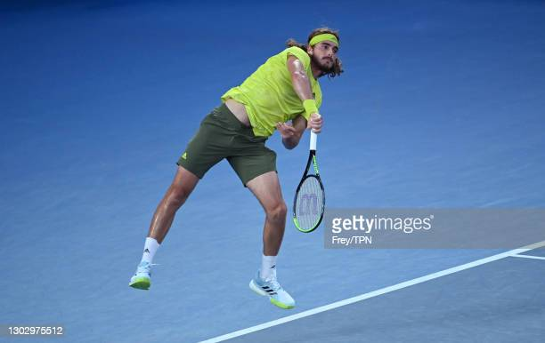 Stefanos Tsitsipas of Greece serves against Daniil Medvedev of Russia in the men's singles semi-finals during day 12 of the 2021 Australian Open at...