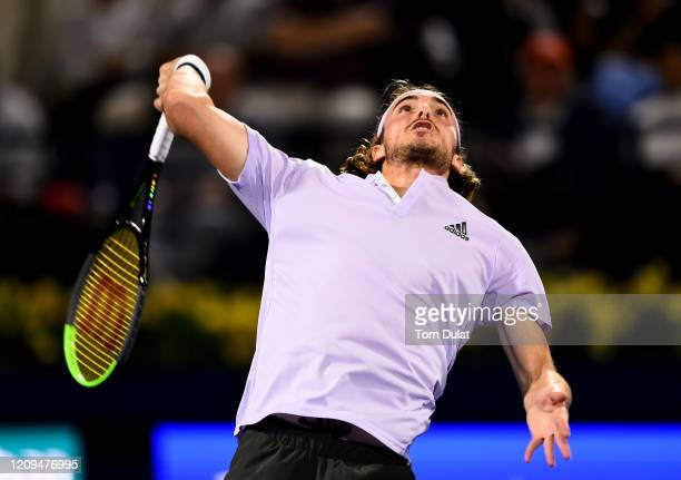 Stefanos Tsitsipas of Greece serves during his men's final match against Novak Djokovic of Serbia on Day 13 of the Dubai Duty Free Tennis at Dubai...