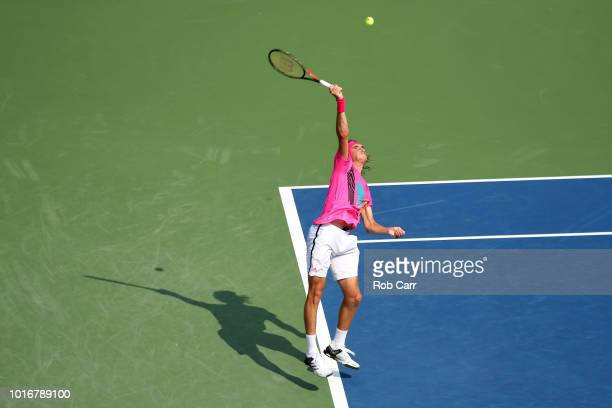 Stefanos Tsitsipas of Greece serves to David Goffin of Belgium during Day 4 of the Western and Southern Open at the Lindner Family Tennis Center on...