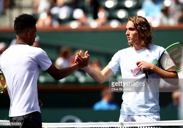 Stefanos Tsitsipas of Greece shakes hands at the net after his straight sets defeat against Felix AugerAliassime of Canadaduring their men's singles...