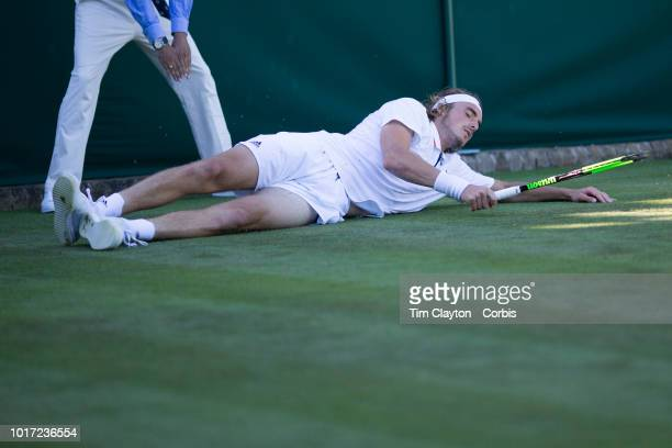 Stefanos Tsitsipas of Greece slips during his match against Gregoire Barrere of France in the Gentlemen's Singles First Round match on Court Eighteen...