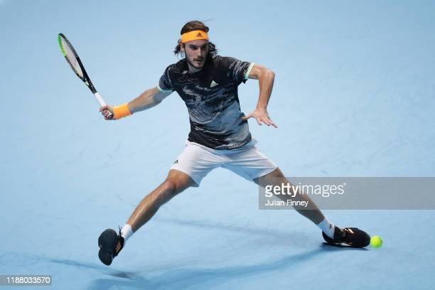 Stefanos Tsitsipas of Greece stretches to play a forehand in his semi-final singles match against Roger Federer of Switzerland during Day Seven of...
