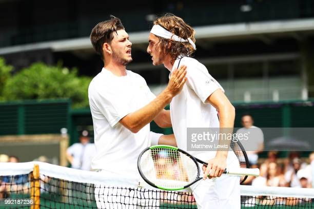 Stefanos Tsitsipas of Greece talks with Jared Donaldson of the United States after their Men's Doubles first round match on day four of the Wimbledon...