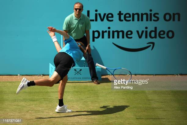 Stefanos Tsitsipas of Greece throws his racket on the floor in frustration during his Quarter-Final Singles Match against Felix Auger-Aliassime of...