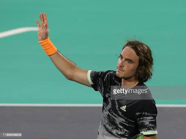 Stefanos Tsitsipas of Greece waves to the public after beating Serbia's Novak Djokovic in their semi-final match of the Mubadala World Tennis...