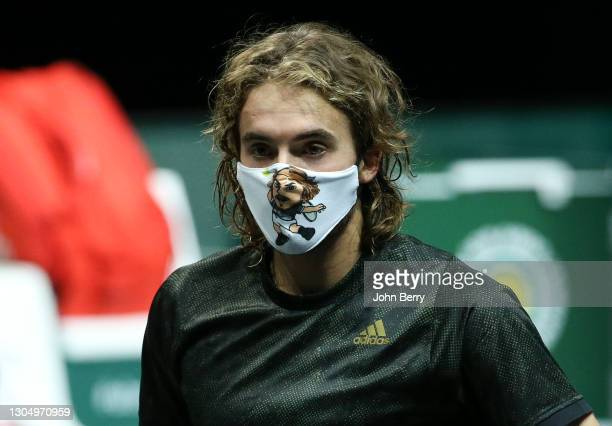 Stefanos Tsitsipas of Greece - wearing a mask with his own image - answers to on-court questions following his first round victory against Egor...