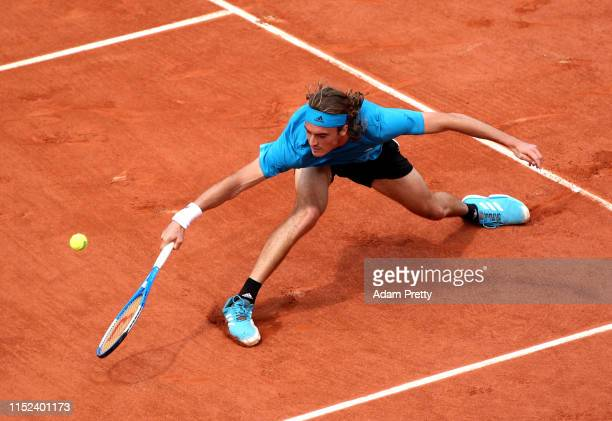 Stefanos Tsitsipas plays a backhand during his mens singles second round match against Hugo Dellien of Bolivia during Day four of the 2019 French...