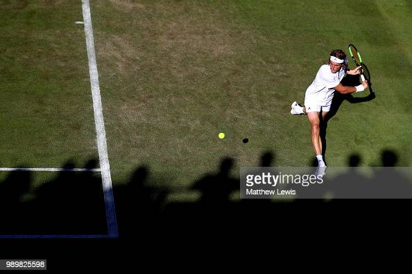 Stefanos Tsitsipas returns against Gregoire Barrere of France during their Men's Singles first round match on day one of the Wimbledon Lawn Tennis...