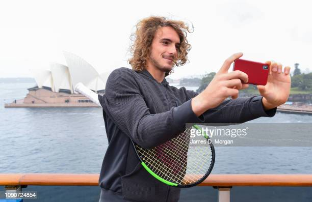Stefanos Tsitsipas takes a selfie with the Opera House behind him during the Fast4 Tennis Launch onboard Carnival Spirit In Sydney Harbour on January...