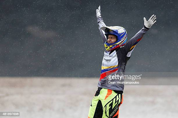 Stefany Hernandez of Venezuela celebrates crosing the finishl line first and winning the Gold Medal in the Women Elite motos during day 5 of the UCI...