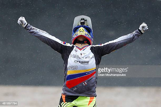 Stefany Hernandez of Venezuela celebrates crossing the finish line first and winning the Gold Medal in the Women Elite motos during day 5 of the UCI...