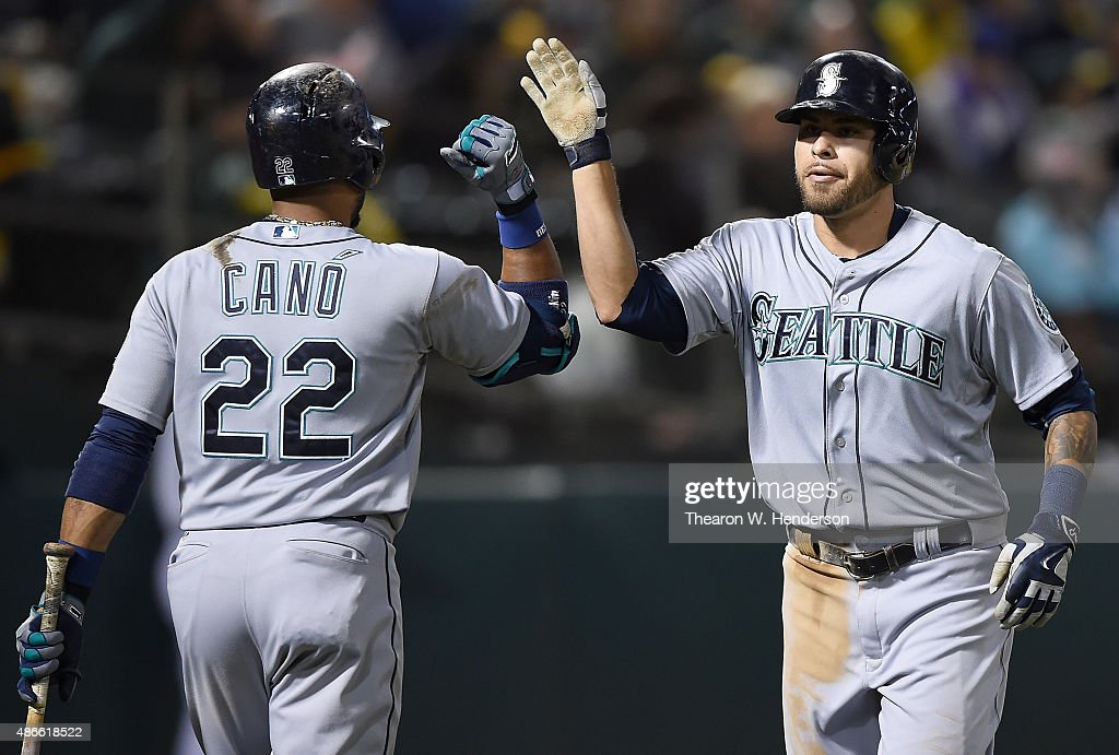 Stefen Romero #17 of the Seattle Mariners is congratulated by Robinson Cano #22 after Romero hit a two-run homer against the Oakland Athletics in the top of the fourth inning at O.co Coliseum on September 4, 2015 in Oakland, California.