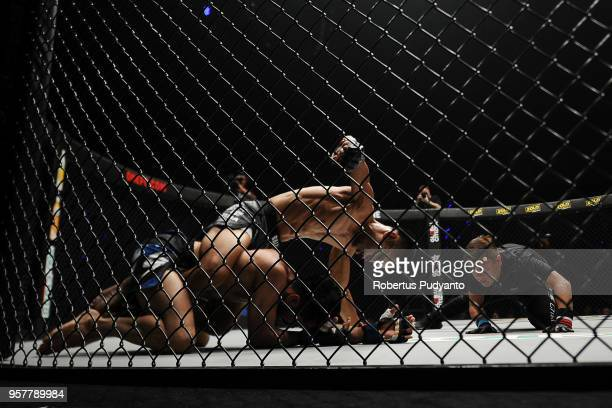 Stefer Rahardian of Indonesia punches against Himanshu Kaushik of India during Strawweight match in the ONE Championship Grit and Glory at Jakarta...