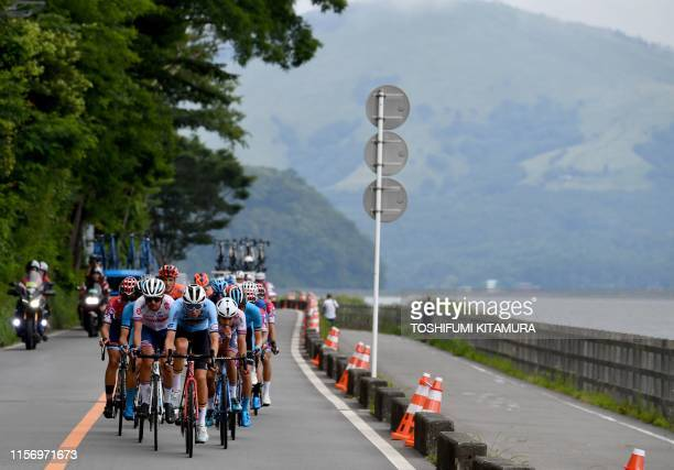 Steff Cras of Belgium leads the pack while riding past Lake Yamanaka during the cycling road race Tokyo 2020 Olympic Games test event in Yamanakako...