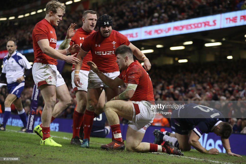 Steff Evan of Wales celebrates with team mates after scoring a second half try during the NatWest Six Nations match between Wales and Scotland at the Principality Stadium on February 3, 2018 in Cardiff, Wales.