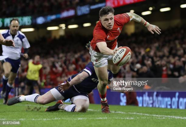 Steff Evan of Wales dives over for a second half try during the NatWest Six Nations match between Wales and Scotland at the Principality Stadium on...