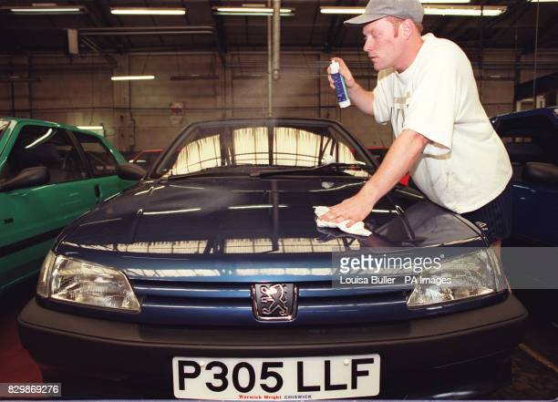 Steffan Fraser of Warwick Wright of Chiswick puts the finishing touches during the preperation of a customers 'P' Registration car that appear on the...