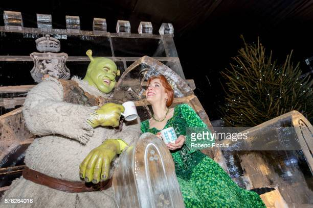 Steffan Harrs performing as Shrek and Laura Main performing as Fiona attend a photocall at Ice Adventures during 'Light Night' the event that...