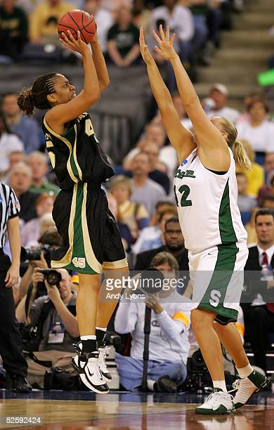 Steffanie Blackmon of the Baylor Lady Bears puts up a shot over Kelli Roehrig of the Michigan State Spartans in the 2005 Women's NCAA Basketball...