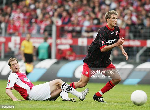 Steffen Baumgart of Cottbus tackles Alexander Meier of Frankfurt during the 2 Bundesliga match between Energie Cottbus and Eintracht Frankfurt at the...
