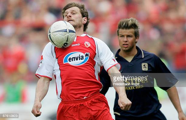 Steffen Baumgarts of Cottbus challenges for the ball with Bjoern Ziegenbein of 1860 during the Second Bundesliga match between Energie Cottbus and...