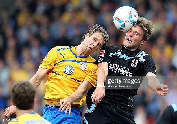 Steffen Bohl of Braunschweig and Dominik Stahl of Muenchen head for the ball during the Second Bundesliga match between Eintracht Braunschweig and...