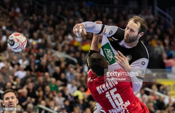 Steffen Faeth of Germany in action with Drasko Nenadic of Serbia during the 26th IHF Men's World Championship group A match between Germany and...