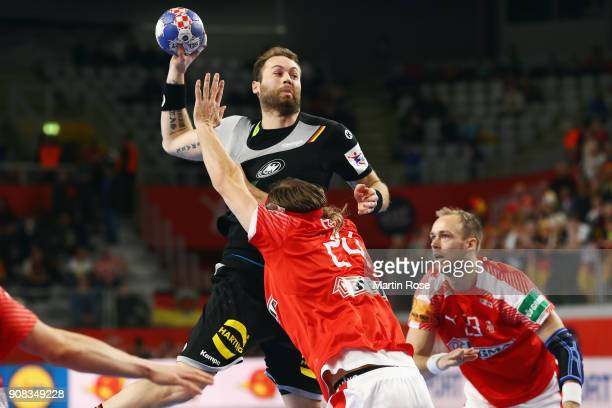 Steffen Faeth of Germany is challenged by Mikkel Hansen of Denmark during the Men's Handball European Championship main round group 2 match between...
