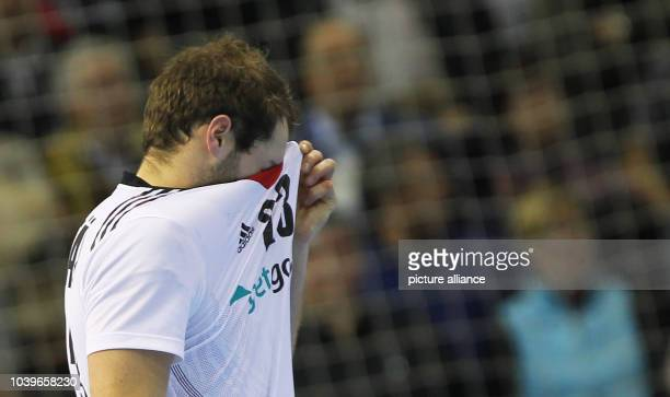 Steffen Faeth of Germany reacts after the men's Handball World Championships quarter-final match Spain vs Germany in Saragossa, Spain, 23 January...