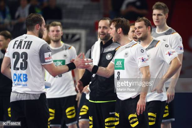 Steffen Faeth of Germany shakes hands with Uwe Gensheimer after being awarded 'Man of the Match' during the Men's Handball European Championship main...