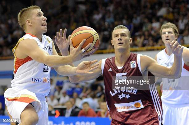 Steffen Hamann of Germany shoots against Andris Biedrins of Latvia during the EuroBasket 2009 Group B match between Germany and Latvia on September 9...
