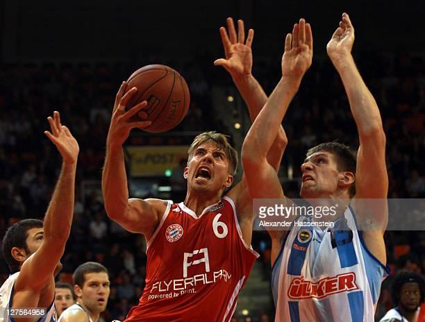 Steffen Hamann of Muenchen battles for the ball with Gasper Vidmar of Uelker during the International Basketball friendly match between FC Bayern...