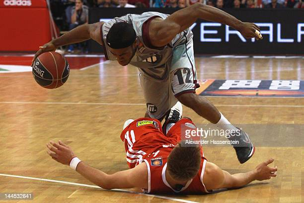 Steffen Hamann of Muenchen fights against Bryan Bailey of Artlan Dragons during Game 4 of the BEKO BBL Quaterfinals between FC Bayern Muenchen and...