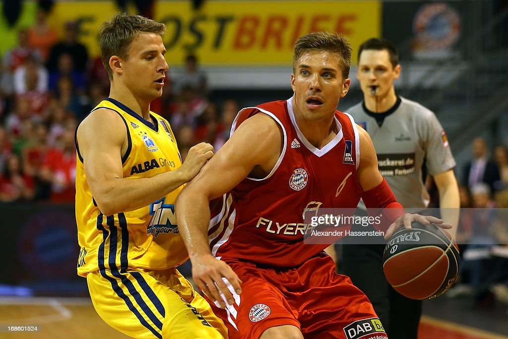 Steffen Hamann of Muenchen shoots against Heiko Schaffartzik of Berlin during Game 3 of the quarterfinals of the Beko Basketball Playoffs between FC Bayern Muenchen and ALBA Berlin at Audi-Dome on May 12, 2013 in Munich, Germany.