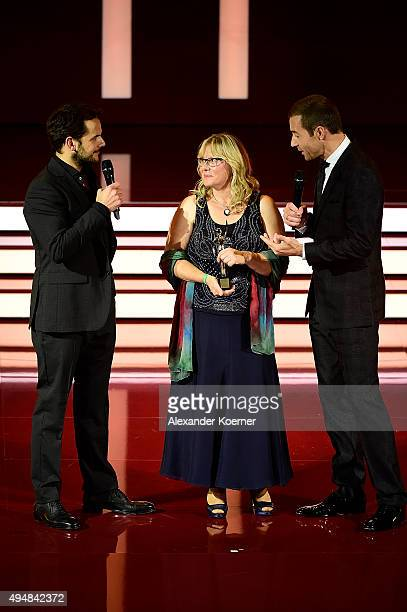 Steffen Henssler Petra Mannfeld and Kai Pflaume are seen during the 'Goldene Bild Der Frau' Award 2015 at Stage Operettenhaus on October 29 2015 in...