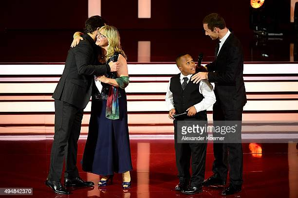 Steffen Henssler Petra Mannfeld Joshua and Kai Pflaume are seen during the 'Goldene Bild Der Frau' Award 2015 at Stage Operettenhaus on October 29...
