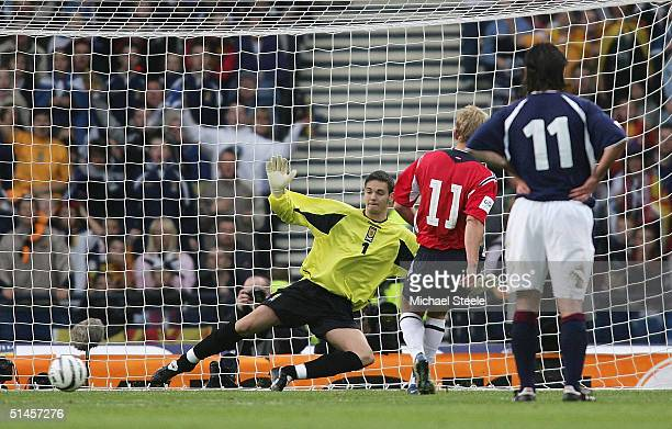 Steffen Iversen of Norway scores from the penalty spot as Craig Gordon the Scotland goalkeeper dives the wrong way during the FIFA World Cup Group 5...