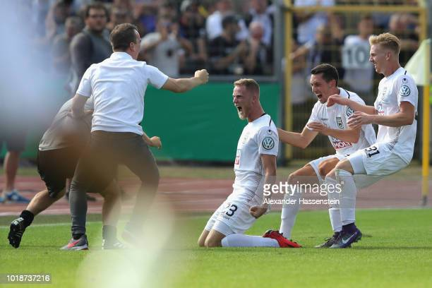 Steffen Kienle of Ulm celebrates scoring the opening goal during the DFB Cup first round match between SSV Ulm 1846 Fussball v Eintracht Frankfurt...
