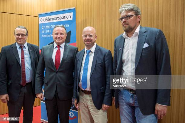 Steffen Koniger Georg Pazderski Andreas Kalbitz and Guido Reil of Antiimmigration populist Alternative fuer Deutschland party pose for a picture...