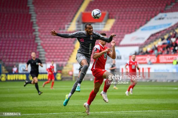 Steffen Nkansah of Zwickau challenges for the ball with Daniel Hanslik of Kaiserslautern during the 3. Liga match between 1. FC Kaiserslautern and...