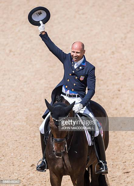 Steffen Peters on Legolas 92 celebrates after performing his routine during the Equestrian's Dressage Grand Prix event of the 2016 Rio Olympic Games...