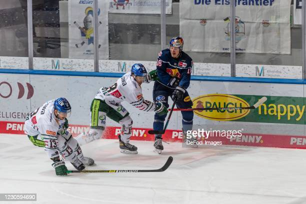 Steffen Toelzer of Augsburger Panther, Samir Kharboutli of Augsburger Panther and Justin Schuetz of EHC Red Bull Muenchen battle for the puck during...