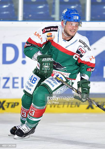 Steffen Toelzer of Augsburger Panther smiles during the action shot on august 15, 2014 in Straubing, Germany.