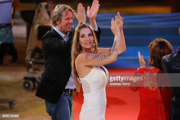 Steffen von der Beeck and Sarah Kern gesture during the finals of 'Promi Big Brother 2017' at MMC Studio on August 25 2017 in Cologne Germany