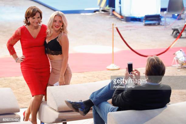 Steffen von der Beeck takes a photograph of Claudia Obert and Evelyn Burdecki attend the finals of 'Promi Big Brother 2017' at MMC Studio on August...