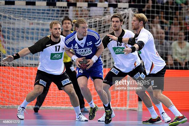 Steffen Weinhold Hendrik Pekeler and Manuel Spaeth of Germany challenge Leonel Henrik Ojala of Finland during the 2016 European Men's Handball...