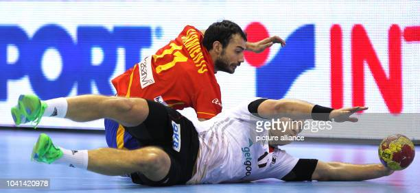 Steffen Weinhold of Germany and Daniel Sarmiento Melian of Spain jump for the ball during the men's Handball World Championships quarter-final match...