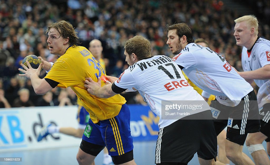 Steffen Weinhold of Germany challenges for the ball with Andreas Nilsson of Sweden during the international handball friendly match between Germany and Sweden at O2 World on January 5, 2013 in Hamburg, Germany.