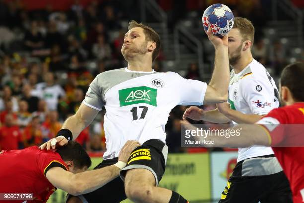 Steffen Weinhold of Germany is challenged by Ace Jonovski of Macedonia during the Men's Handball European Championship Group C match between Germany...